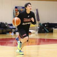 Asami Yoshida, the captain of the Japan women's national team for this summer's FIBA Asia Championship, dribbles during a training camp at the National Training Center on Wednesday. | KAZ NAGATSUKA