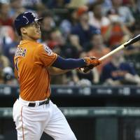 Houston's Carlos Correa watches his home run leave the yard against Seattle in the first inning on Friday night. The Astros whitewashed the Mariners 10-0. | USA TODAY SPORTS
