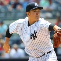 Tanaka roughed up as Tigers maul Yanks