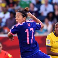 Forward Yuki Ogimi (left) and Ecuador's forward Giannina Lattanzio vie for the ball on Tuesday during their Group C football match of the 2015 FIFA Women's World Cup in Winnipeg, Manitoba. Ogimi scored a goal to put Japan at the top of their group after three games. | AFP-JIJI