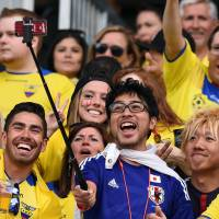 Fans of Japan and Ecuador soccer teams take a 'selfie' on Tuesday at the Winnipeg Stadium before the start of the Group C football match of the 2015 FIFA Women's World Cup between Japan and Ecuador in Winnipeg, Manitoba. | AFP-JIJI