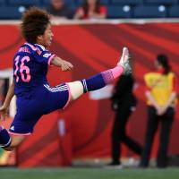 Japan's forward Mana Iwabuchi stretches in the air to reach the ball during their third game of the 2015 FIFA Women's World Cup against Ecuador in Winnipeg, Manitoba. | AFP-JIJI