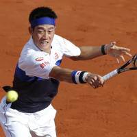 Nishikori falls to Tsonga in French Open quarterfinals