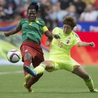 Yuika Sugasawa vies for the ball with Cameroon's Christine Manie in the second half of their Women's World Cup Group C match on Friday night in Vancouver, British Columbia. Japan won 2-1.   AP