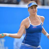 Wozniacki quits semi with back injury