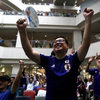 Japan's soccer fans celebrate their victory over England at FIFA Women's World Cup semi-final soccer match, at a public viewing event in Tokyo on July 2. | REUTERS