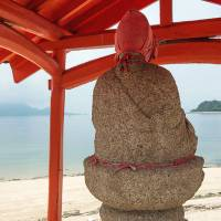 A Jizo statue on a stretch of natural beach just south of Setoda. | STEPHEN MANSFIELD