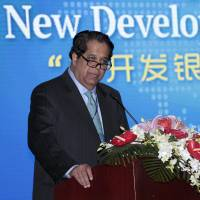 Kundapur Vaman Kamath, president of the New Development Bank, gives a speech during an opening ceremony of the bank in Shanghai on Tuesday. | REUTERS