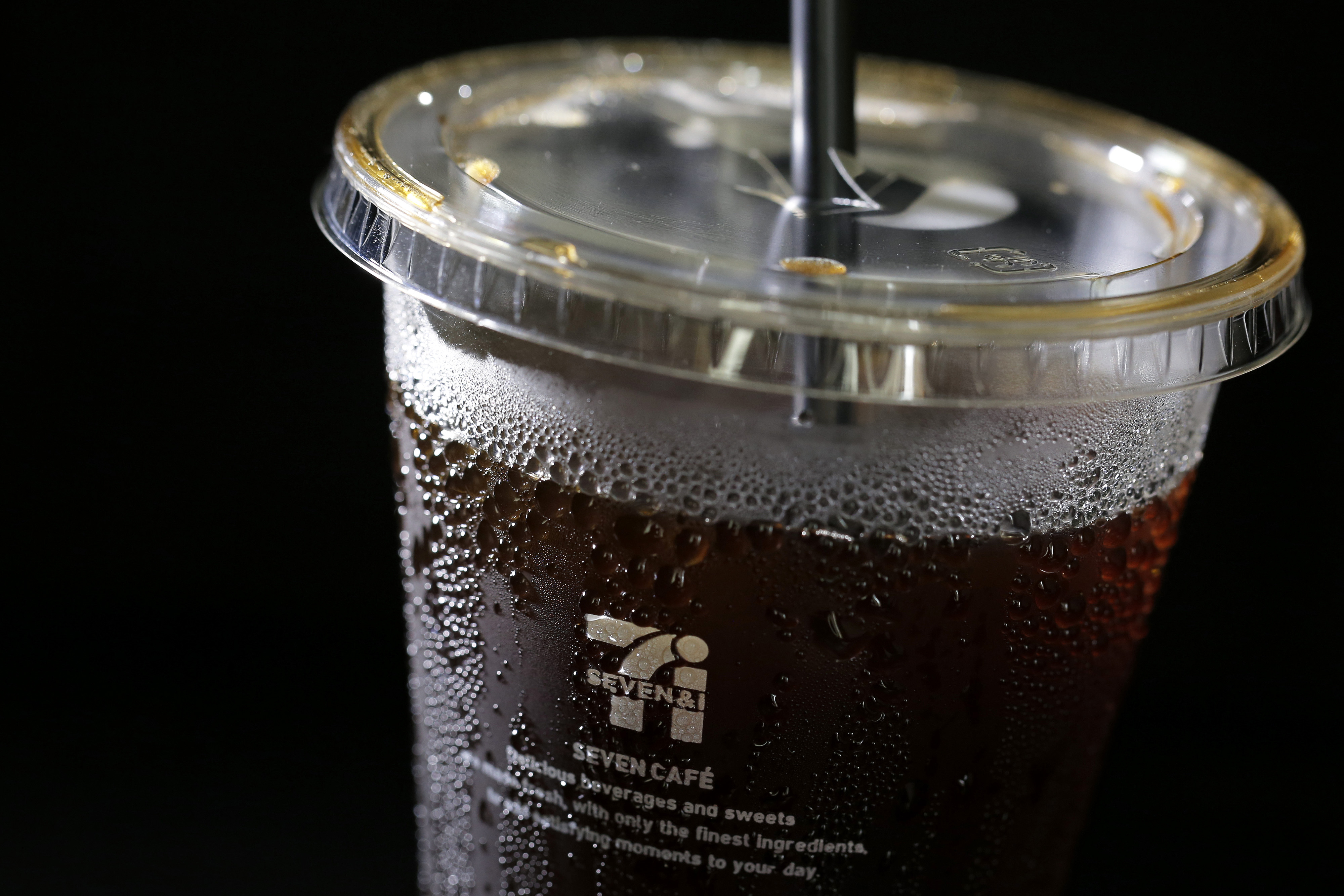 A cup of ice coffee sold at a 7-Eleven convenience store is seen in Tokyo on June 30.   BLOOMBERG