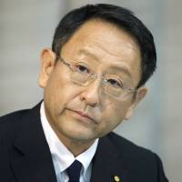 Akio Toyoda, president of Toyota Motor Corp., listens at a news conference in Tokyo on June 19 at which he expressed support for communications director Julie Hamp following her arrest. | BLOOMBERG