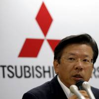 Mitsubishi Motors Corp. President Tetsuro Aikawa speaks during a news conference at the company's headquarters in Tokyo on Monday. The automaker said it will stop making vehicles in the U.S. this year and will close down its plant in Illinois if no buyer is found. | REUTERS