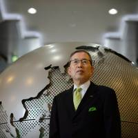 Nidec Corp. CEO Shigenobu Nagamori poses for a photograph in the lobby of the company's headquarters in Kyoto in May. | BLOOMBERG