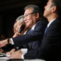 Nikkei Chairman and CEO Tsuneo Kita addresses a news conference in Tokyo on Friday.   AP