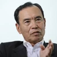 Tatsumaro Terazawa, chairman of the Regional Banks Association of Japan, speaks during an interview in Yokohama in June. A ruling party proposal to raise the ¥10 million cap on deposits at Japan Post Bank must be withdrawn, he said. | BLOOMBERG