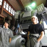 Kogoro Kurata (right) poses with the Kuratas robot in Yamanashi Prefecture in September 2012. | KAZUAKI NAGATA