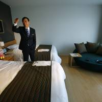 Huis Ten Bosch Co. President Hideo Sawada speaks in a guest room at the newly opened robot hotel, aptly called Henn na Hotel, or Weird Hotel, in Sasebo, Nagasaki Prefecture, on Wednesday | AP