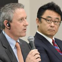 Franklin Pray (left), CEO of Intrepid Aviation, answers questions next to Masaru Morimoto (right), managing director of Delta Air Lines Japan, during a news conference in Tokyo on Wednesday. | AFP-JIJI