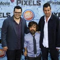 Actors Josh Gad (left), Peter Dinklage (center) and Adam Sandler attend the premiere of the movie 'Pixels' in New York on July 18. | REUTERS