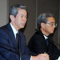 Toshiba Corp. President Hisao Tanaka (left) faces the media during a news conference about the firm's accounting scandal in Tokyo on Tuesday. | SATOKO KAWASAKI