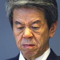 Toshiba Corp. CEO Hisao Tanaka grimaces during a news conference Tuesday to announce his resignation at the company's headquarters in Tokyo. | AP