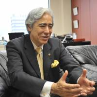 Wendy's Japan chief Ernest M. Higa speaks about the firm's future strategy during an interview earlier this month at the company's head office in Tokyo. | KAZUAKI NAGATA