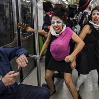 Clowns, masked hero use humor in bid to make Mexico City safer for pedestrians, subway riders