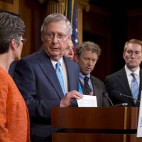 Senate Majority Leader Mitch McConnell, joined by (from left) Sen. John Thune, Sen. Joni Ernst, Republican presidential candidate, Sen. Rand Paul, and Sen. James Lankford, peaks during a news conference on Capitol Hill in Washington, Wednesday to discuss Planned Parenthood. | AP