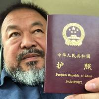 China gives Ai Weiwei his passport back after 4 years