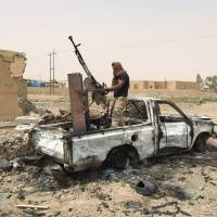 Iraqi forces attack Islamic State near Anbar base; crashed drone found