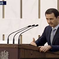 Assad makes rare TV appearance, admits troop shortage; forces close in on Palmyra
