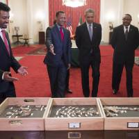 Obama shown Lucy in Ethiopia, hits 'sad' Republican refrains