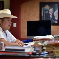 Mario Valenzuela, mayor of the Badiraguato community in Sinaloa State, Mexico, speaks during an interview with AFP on Friday. One week after drug boss Joaquin Guzman escaped prison again, his legend has grown in his home region in northwestern Sinaloa state, where he is revered as a benevolent bandit despite his drug cartel's murderous record.   AFP-JIJI