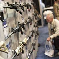 Rifles are displayed at Colt's Manufacturing Co.'s booth at the 144th National Rifle Association annual meeting and exhibit at the Music City Center in Nashville, Tennessee, in April. | BLOOMBERG