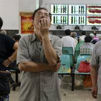 Losing $1 billion a minute, China blames foreigners, speculators for selloff
