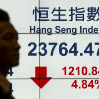 China stocks nosedive as regulator warns of 'panic'