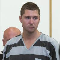 White Cincinnati campus cop pleads not guilty to murdering black motorist; $1 million bail set