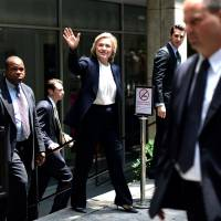 Mindful of rise of liberal Sanders, Clinton bashes Wall Street, vows wage equality