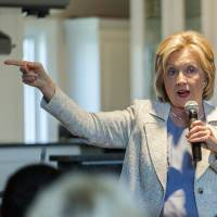 Democratic U.S. presidential candidate Hillary Rodham Clinton speaks at an organizing house party in the Kraus home in Carroll, Iowa, Sunday, when she unveiled her climate goals, including a strong push for solar power. | REUTERS