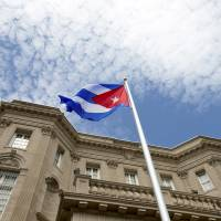 Havana hoists flag at Cuban Embassy in U.S. but enmities linger after five-decade chill