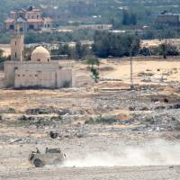 Egypt planes pound Islamic State positions in Sinai as troops hunt house-to-house