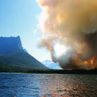 Glacier National Park wildfire rages out of control for third day; historic cabin lost