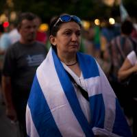 Demonstrators gather near the Greek Parliament in protest at the government's agreement with creditors in Athens on Tuesday. | AP