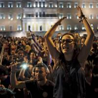 'No' supporters shout slogans during celebrations following a referendum in front of the parliament in Athens on Sunday. Greeks overwhelmingly rejected conditions of a rescue package from creditors on Sunday, throwing the future of the country's eurozone membership into further doubt and deepening a standoff with lenders. | REUTERS