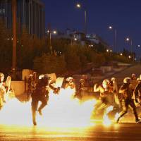 Riots rage outside as Greek parliament debates painful bailout terms