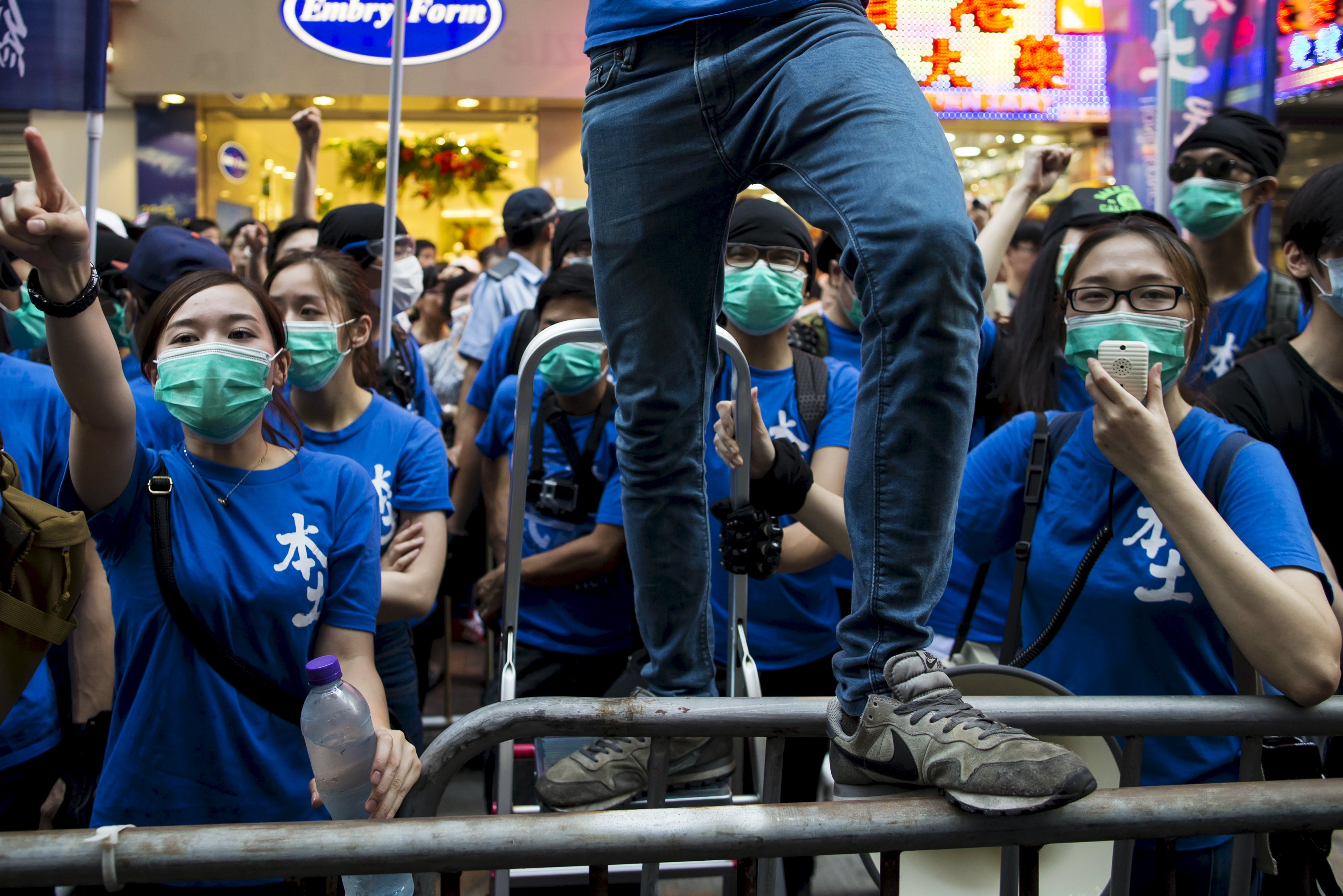 Anti-Beijing demonstrators shout at a pro-China group in Hong Kong's Mong Kok shopping district on July 11.   REUTERS