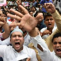 Activists of the Indian Youth Congress (IYC) shout anti-goverment slogans during a protest Monday in New Delhi following a suspected militant attack in Punjab's Gurdaspur district. | AFP-JIJI