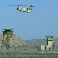 An Iranian military helicopter flies over the Natanz nuclear facility in this 2005 file photo. | AFP-JIJI
