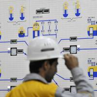 An Iranian operator monitors the nuclear power plant unit in Bushehr in this November 2009 file photo. Iran and six major world powers have reached a nuclear deal after more than a decade of on-and-off negotiations, granting Tehran sanctions relief in exchange for curbs on its nuclear program. | REUTERS