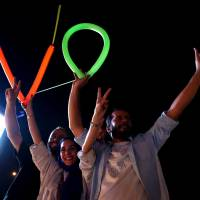 Nuclear deal sends Iranians, after fasting ends, dancing into the streets of Tehran
