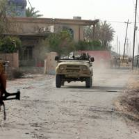 Shiites, other Iraqi forces meet heavy resistance in effort to surround Islamic State's Falluja base
